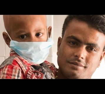 Bangladesh boy with mask and father World Child Cancer patient