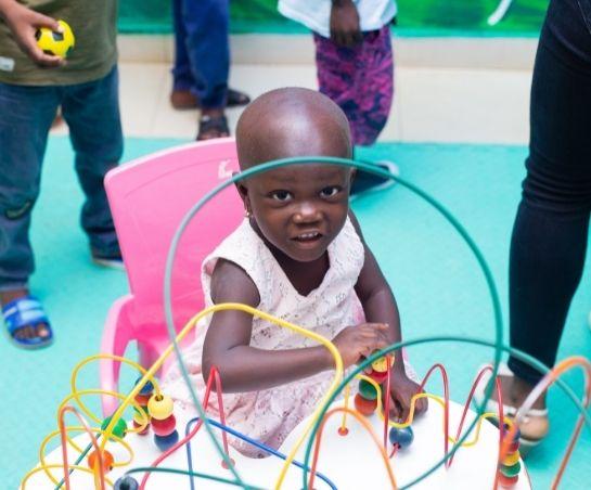 Girl Playing KBTH World Child Cancer